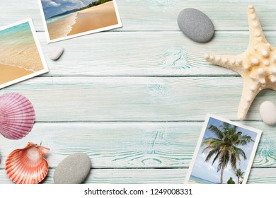 Travel vacation background concept with seashells and summer photos on wooden table. Top view with copy space. Flat lay. Photos taken by me