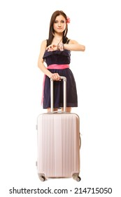 Travel vacation concept. Summer fashion woman in voyage, girl in full length with pink suitcase luggage bag looking at hand watch.