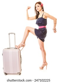 Travel vacation concept. Young summer fashion woman in voyage, girl in full length with pink suitcase luggage bag.