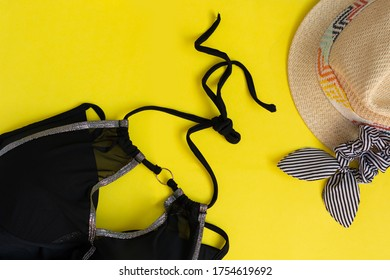 Travel and vacation during the coronavirus quarantine. masks in public places. Covid-19 pandemic concept.Mask,sunglasses,  swimsuit, hat. Top view. Summer flat lay. Copy space
