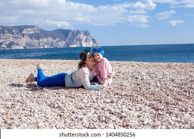 travel vacation of the happy family at the beach gaginst the sky and sea. toung woman with headbandare huge the kid