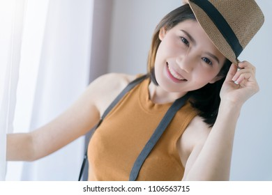 travel and vacation ideas concept with beautiful asian woman take photo with happiness and joyful white room background