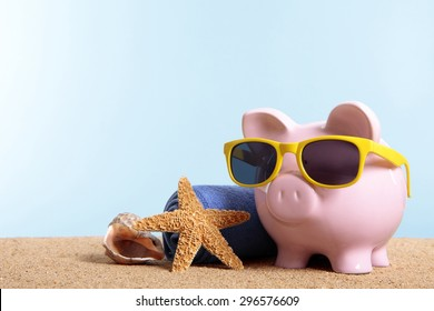 Travel vacation money saving concept, piggybank beach holiday.  Copy space.