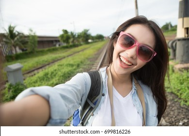 Travel Vacation Tourist Selfie. Asia woman taking self-portrait photo.