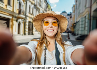 Travel Vacation Tourist Selfie. Woman taking self-portrait photo on Europe. Girl on summer vacation visiting famous tourist destination having fun smiling