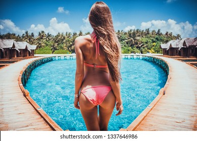 Travel vacation wallpaper - Beautiful young blonde girl in bikini with white sand on her perfect sport sexy body relax in sea of white sand paradise tropical maldives resort pool at sunny day bungalow