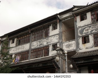 Travel view of downtown Dali featuring Dali bai house architecture. The image location is Dali in Yunnan, China.