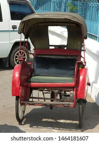 Travel view of Java featuring Java rickshaw cart wheels. The image location is Java in Asia.