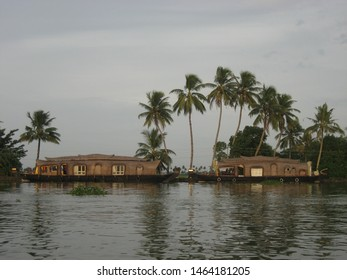 Travel view of Kerala houseboats featuring canal houseboats. The image location is Kerala in India, Asia.