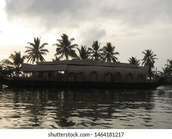Travel view of Kerala houseboats featuring canal houseboat. The image location is Kerala in India, Asia.