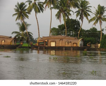 Travel view of Kerala houseboats featuring canal houseboat dreamland journey. The image location is Kerala in India, Asia.