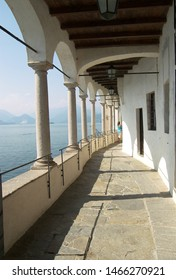 Travel view of Lake Maggiore featuring Santa Caterina del Sasso monastery path loggia. The image location is lakes in Italy, Europe.