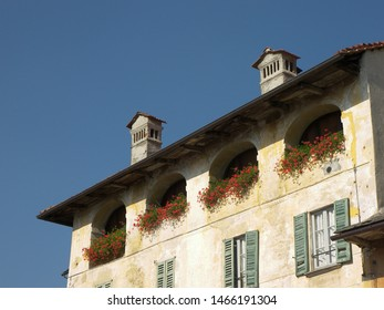 Travel view of Lake Orta featuring center house loggia. The image location is lakes in Italy, Europe.