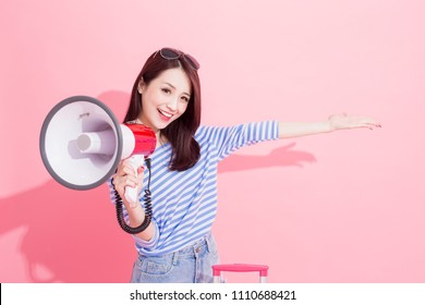 travel woman take microphone and show something to you with travel concept