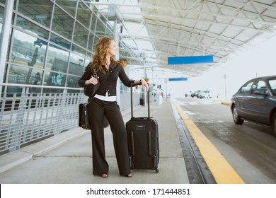 Travel: Woman Waits At Airport For Ride To Show