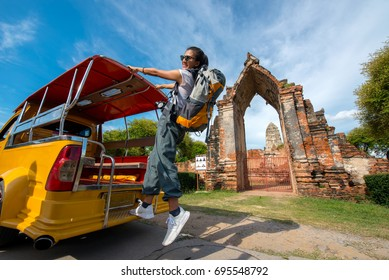 Travel young women go to landmarks at ayutthaya by tuk tuk taxi,Ayutthaya province Thailand.