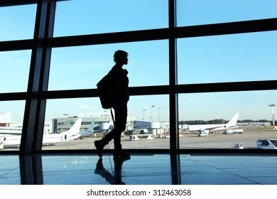 traveler at the airport. silhouette of a girl with a backpack. business and travel