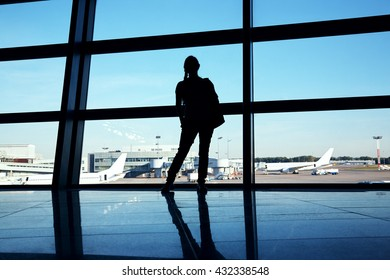 traveler at the airport. silhouette of a woman with a backpack. business and travel