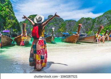 Traveler Asian woman in summer dress joy relaxing on sunny beach Maya bay Phi Phi island Krabi Travel Thailand fun beach, Tourism beautiful destination place Asia, Girl on summer holiday vacation trip - Shutterstock ID 1060287521