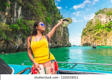 Traveler Asian woman in summer dress joy relaxing on boat at Pileh lagoon, Krabi, Phuket, Travel adventure nature Thailand, Tourist beautiful destination Asia, Summer holiday outdoor vacation trip