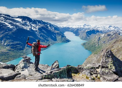 Traveler with backpack and amazing fjord panorama. Norway