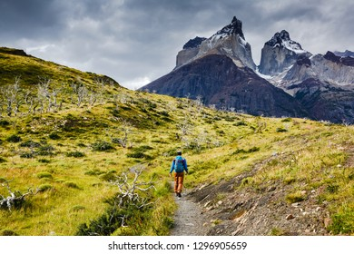 Traveler with Backpack hiking in Torres del Paine national park, Patagonia, Chile