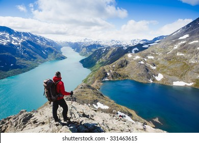 Traveler with backpack and mountain panorama. Norway