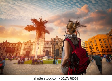 A traveler with a backpack. Panoramic view of Lima main square and cathedral church.