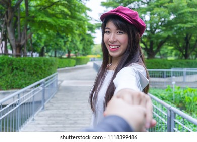 Traveler couple holding hands together on vacation. Woman walking leading lover on summer holiday. Romantic honeymoon lifestyle concept