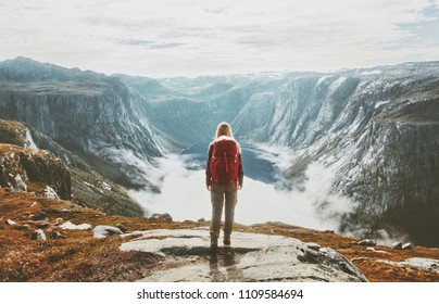 Traveler exploring mountains alone hiking with backpack adventure journey summer vacations traveling lifestyle weekend getaway in Norway