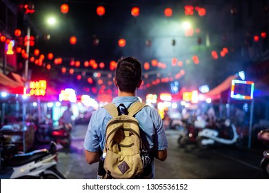 Traveler exploring the streets of Asian food market