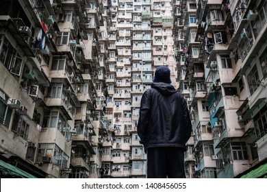 Traveler exploring the urban landscape of Hong Kong, China, one of the most densely populated cities in the world.