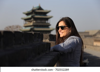 Traveler Girl at the ancient City of Ping Yao (UNESCO World Heritage site). A famous historic site in Pingyao, Shanxi, China.
