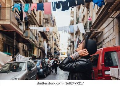 Traveler girl exploring city of Naples, Italy