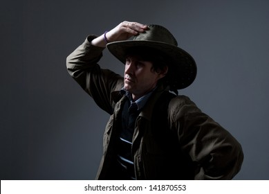 A traveler in a hat looking to the side.