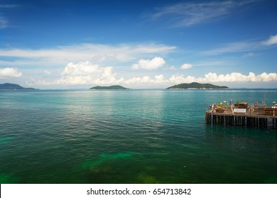 Traveler have fun on the jetty of the port in the sunny day , Rawa island , Malaysia .