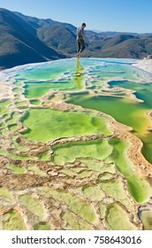 Traveler at Hierve el Agua, thermal spring in the Central Valleys of Oaxaca, Mexico