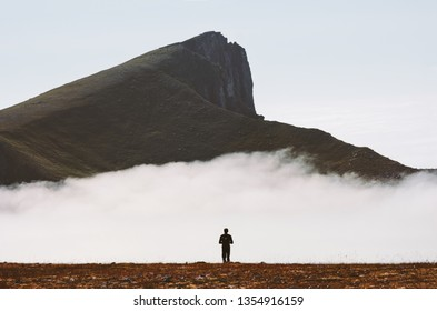 Traveler hiking alone in cloudy mountains travel adventure active lifestyle summer vacations outdoor
