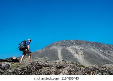 traveler hiking on Besseggen ridge in Jotunheimen National Park, Norway