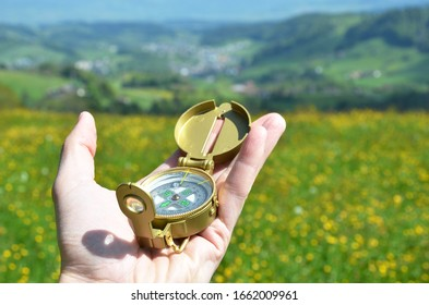 Traveler holding compass in the hand