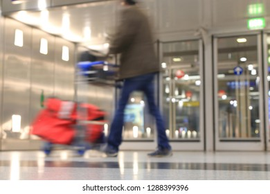 Traveler hurries to the gate in the airport in blurd view