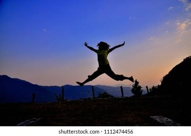traveler jumping for good life