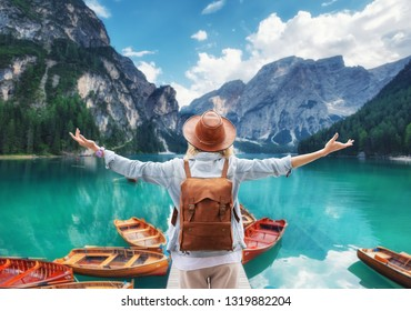 Traveler look at the mountain lake. Travel and active life concept. Adventure and travel in the mountains, Lago di Braers lake, Dolomite Alps, Italy.