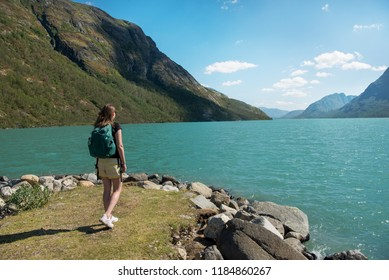 traveler looking at Gjende lake in Jotunheimen National Park, Norway