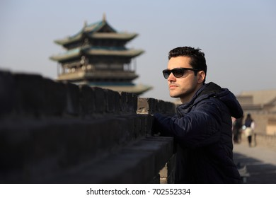 Traveler man at the ancient City of Ping Yao (UNESCO World Heritage site). A famous historic site in Pingyao, Shanxi, China.