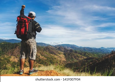 Traveler Man with backpack hands raised mountains landscape on background Lifestyle Travel happy emotions success concept summer vacations outdoor.