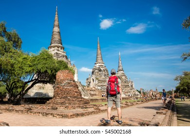 Traveler Man with backpack. Travel Lifestyle concept. Ayutthaya Thailand - ancient city and historical place. Wat Phra Si Sanphet
