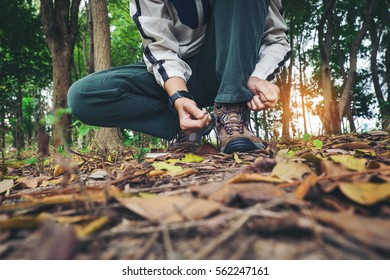 Traveler man Hands Lacing up Trekking Shoes