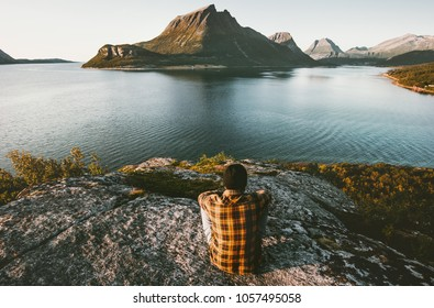 Traveler Man relaxing with sea and mountains view Travel lifestyle adventure outdoor summer vacations alone into the wild nature