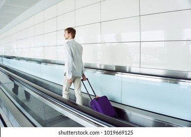 traveler man with a suitcase at airport
